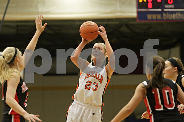 Rob Winner – rwinner@shawmedia.com<br /> <br /> DeKalb's Madelyne Johnson puts up a shot in the first quarter during the Class 4A Belvidere North Regional semifinal in Belvidere, Ill., Tuesday, Feb. 12, 2013.