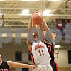 Rob Winner – rwinner@shawmedia.com<br /> <br /> DeKalb's Courtney Patrick (11) and Huntley's Sam Andrews (right) try to control a rebound under the Barbs' basket in the fourth quarter during the Class 4A Belvidere North Regional semifinal in Belvidere, Ill., Tuesday, Feb. 12, 2013.
