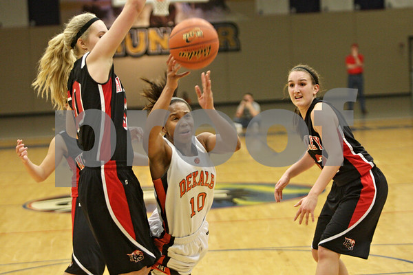 Rob Winner – rwinner@shawmedia.com<br /> <br /> DeKalb's Brittney Patrick (10) loses her grip on a ball during a shot in the fourth quarter during the Class 4A Belvidere North Regional semifinal in Belvidere, Ill., Tuesday, Feb. 12, 2013.