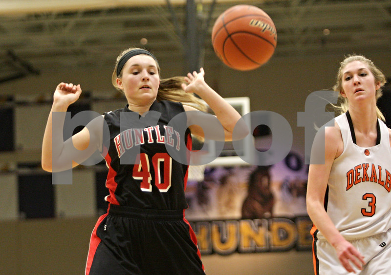 Rob Winner – rwinner@shawmedia.com<br /> <br /> Huntley's Sam Andrews (40) lets a ball go out-of-bounds after being last touched by a DeKalb player in the second quarter during the Class 4A Belvidere North Regional semifinal in Belvidere, Ill., Tuesday, Feb. 12, 2013.
