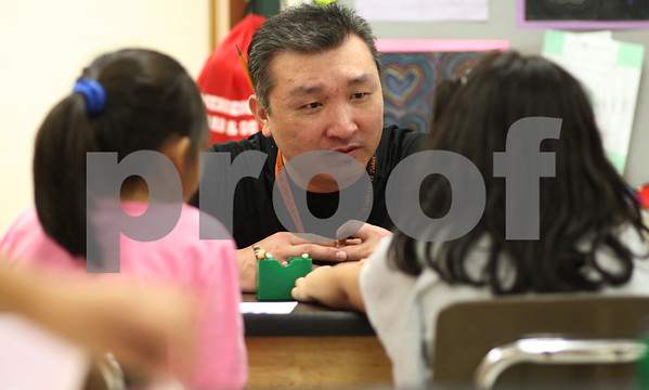Kyle Bursaw – kbursaw@shawmedia.com<br /> <br /> John Hahn works with two second-graders at Founders Elementary in DeKalb, Ill. on Tuesday, Jan. 29, 2013, his first day back to teaching after suffering a ruptured brain aneurysm on November 21, 2011.