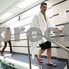Kyle Bursaw – kbursaw@shawmedia.com<br /> <br /> DeKalb teacher John Hahn, walks out from the therapy pool area of Unlimited Performance as physical therapist Melissa Stevens uses a towel to dry behind him around 5 p.m taking care of some of the last of his responsibilities on his first day back to teaching. It was the conclusion one of the longest days in a while for Hahn, who woke up at 6:30 a.m. that day. Hahn was so worn out from the first day back in 14 months that he missed the next two days at school.