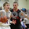 Rob Winner – rwinner@shawmedia.com<br /> <br /> Hinckley-Big Rock's Michael Bayler (left) drives to the basket past Indian Creek's Jake Bjorneby in the first quarter during the Little 10 Conference tournament final in Somonauk, Ill., Friday Feb. 1, 2013