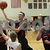 Rob Winner – rwinner@shawmedia.com<br /> <br /> Indian Creek's Kyle Lieving puts up a shot in the second quarter during the Little 10 Conference tournament final in Somonauk, Ill., Friday Feb. 1, 2013