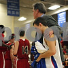 Rob Winner – rwinner@shawmedia.com<br /> <br /> Hinckley-Big Rock coach Bill Sambrookes leads Bernie Conley off the court after the Class 1A Westminster Christian Regional final at Judson University in Elgin, Ill., Friday, Feb. 22, 2013. Mooseheart defeated Hinckley-Big Rock, 55-38.