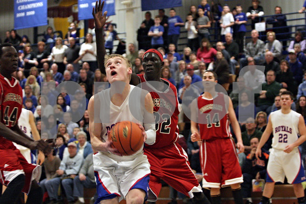 Rob Winner – rwinner@shawmedia.com<br /> <br /> Hinckley-Big Rock's Michael Bayler looks to the basket before taking a shot in the first quarter during the Class 1A Westminster Christian Regional final at Judson University in Elgin, Ill., Friday, Feb. 22, 2013. Mooseheart defeated Hinckley-Big Rock, 55-38.