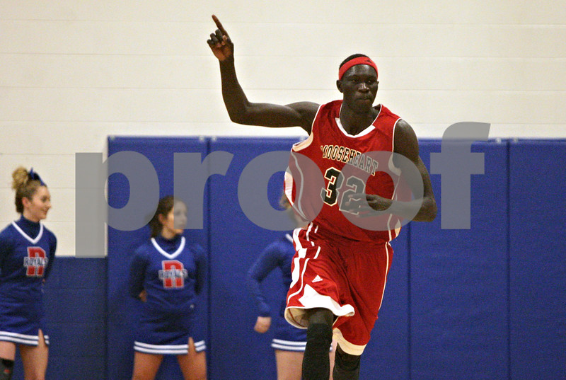 Rob Winner – rwinner@shawmedia.com<br /> <br /> Mooseheart's Makur Puou reacts after a slam dunk in the first quarter during the Class 1A Westminster Christian Regional final at Judson University in Elgin, Ill., Friday, Feb. 22, 2013. Mooseheart defeated Hinckley-Big Rock, 55-38.