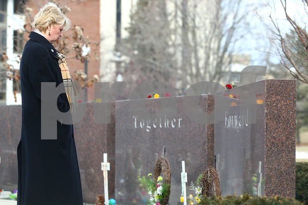 Kyle Bursaw – kbursaw@shawmedia.com<br /> <br /> Northern Illinois University employee Kathy Buettner takes a moment to pause in front of each student's name at the memorial following the wreath-laying ceremony in DeKalb, Ill. on Thursday, Feb. 14, 2013.