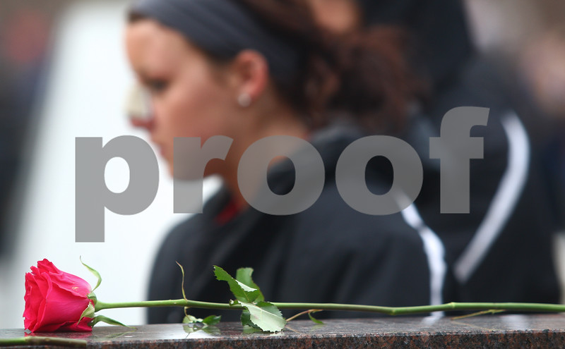 Kyle Bursaw – kbursaw@shawmedia.com<br /> <br /> During a memorial service on the fifth anniversary of the tragedy, people walk past the memorials of the five students killed in Cole Hall, some leaving flowers in DeKalb, Ill. on Thursday, Feb. 14, 2013.