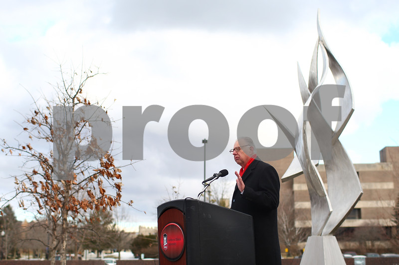 Kyle Bursaw – kbursaw@shawmedia.com<br /> <br /> Northern Illinois University President John Peters addresses the crowd that showed up on the fifth anniversary to remember the victims of the Cole Hall shooting in front of the building in DeKalb, Ill. on Thursday, Feb. 14, 2013.