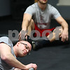 Kyle Bursaw – kbursaw@shawmedia.com<br /> <br /> Following a workout, Kyle Kralka (front) rolls a barbell on his forearm as Trent Feeney rests after foam rolling on Monday, Feb. 18, 2013 at Sycamore CrossFit.