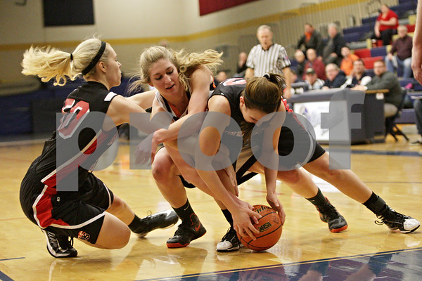Rob Winner – rwinner@shawmedia.com<br /> <br /> Huntley's Ali Andrews (from left to right), DeKalb's Courtney Bemis and Hunltley's Haley Ream struggle for a ball under the Barbs' basket in the first quarter during the Class 4A Belvidere North Regional semifinal in Belvidere, Ill., Tuesday, Feb. 12, 2013.