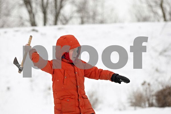 Rob Winner – rwinner@shawmedia.com<br /> <br /> Seth Wickens-Walther, 11, of DeKalb Cub Scout Pack 173 tosses a tomahawk at a tree stump during the annual Klondike Derby held at Sycamore's Sportsman's Club in Sycamore, Ill., Saturday, Feb. 2, 2013.
