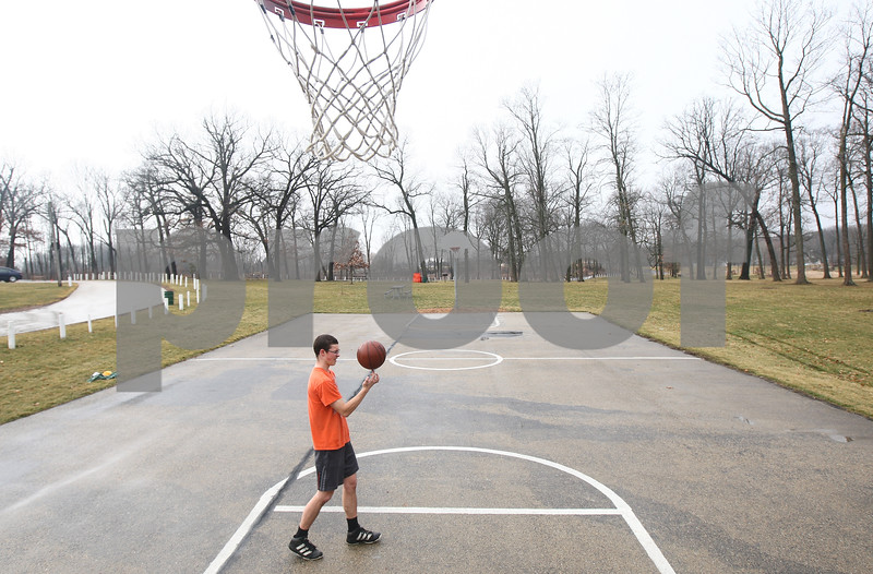Kyle Bursaw – kbursaw@shawmedia.com<br /> <br /> DeKalb resident Gary Dornbush, 20, spins the basketball on his finger while shooting around in a short-sleeve shirt at Hopkins Park on Tuesday, Jan. 29, 2013.