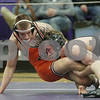 Rob Winner – rwinner@shawmedia.com<br /> <br /> East Moline's Tanner Schuldt (left)competes against Sycamore's Austin Culton during their 152-pound finals match at the Class 2A Rochelle Sectional on Saturday, Feb. 9, 2013. Culton won with a 11-6 decision.
