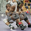 Rob Winner – rwinner@shawmedia.com<br /> <br /> Kaneland's Esai Ponce (left) competes against Washington's Randy Meneweather during their 132-pound third place match at the Class 2A Rochelle Sectional on Saturday, Feb. 9, 2013. Ponce won with a 7-0 decision.