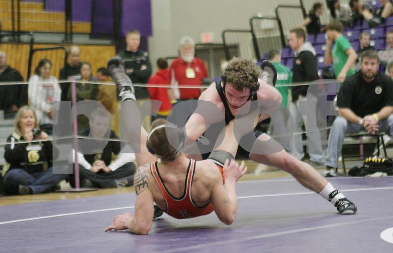 Rob Winner – rwinner@shawmedia.com<br /> <br /> East Moline's Tanner Schuldt (left) is taken to the mat by Sycamore's Austin Culton during their 152-pound finals match at the Class 2A Rochelle Sectional on Saturday, Feb. 9, 2013. Culton won with a 11-6 decision.