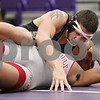 Rob Winner – rwinner@shawmedia.com<br /> <br /> Sycamore's Jake Davis (top) pins Yorkville's Will Fergason in their 195-pound match during the Class 2A Rochelle Dual Team Sectional on Tuesday, Feb. 19, 2013. Sycamore defeated Yorkville, 30-28.