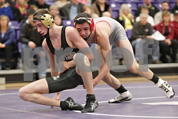 Rob Winner – rwinner@shawmedia.com<br /> <br /> Sycamore's Brendon McGehee (left) competes with Yorkville's Brody Sharp in their 126-pound match during the Class 2A Rochelle Dual Team Sectional on Tuesday, Feb. 19, 2013. McGehee won with a 3-2 decision. Sycamore defeated Yorkville, 30-28.