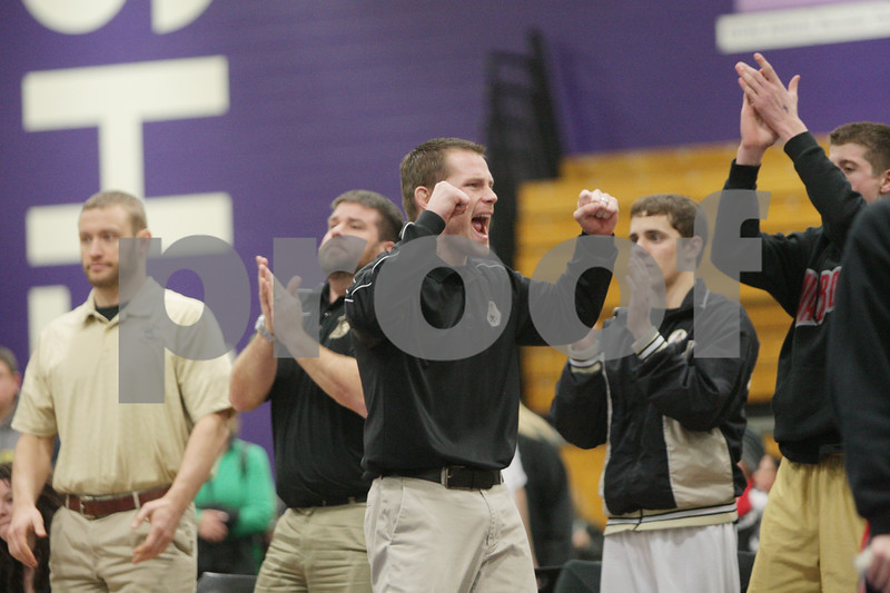 Rob Winner – rwinner@shawmedia.com<br /> <br /> Sycamore coach Alex Nelson reacts after Sycamore defeated Yorkville, 30-28, during the Class 2A Rochelle Dual Team Sectional on Tuesday, Feb. 19, 2013.