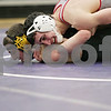 Rob Winner – rwinner@shawmedia.com<br /> <br /> Yorkville's Brennan Sharp (top) controls Sycamore's Andrew Larsen in their 138-pound match during the Class 2A Rochelle Dual Team Sectional on Tuesday, Feb. 19, 2013. Sharp won with a 8-0 decision. Sycamore defeated Yorkville, 30-28.
