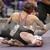 Rob Winner – rwinner@shawmedia.com<br /> <br /> Sycamore's Collin Druck (front) is controlled by Yorkville's CJ Milliron in their 120-pound match during the Class 2A Rochelle Dual Team Sectional on Tuesday, Feb. 19, 2013. Milliron won with a 11-4 decision. Sycamore defeated Yorkville, 30-28.