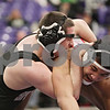 Rob Winner – rwinner@shawmedia.com<br /> <br /> Sycamore's Ren Swick (left) competes with Yorkville's Tyler Wilkinson in their 170-pound match during the Class 2A Rochelle Dual Team Sectional on Tuesday, Feb. 19, 2013. Swick won with a 6-2 decision. Sycamore defeated Yorkville, 30-28.