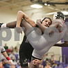 Rob Winner – rwinner@shawmedia.com<br /> <br /> Sycamore's Dylan Foster (left) takes Yorkville's Bryce Shewan to the mat in their 145-pound match during the Class 2A Rochelle Dual Team Sectional on Tuesday, Feb. 19, 2013. Foster won with a 7-3 decision. Sycamore defeated Yorkville, 30-28.