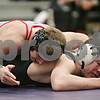 Rob Winner – rwinner@shawmedia.com<br /> <br /> Yorkville's Gunnar Hjorth (top) controls Sycamore's Austin Armstrong in their 160-pound match during the Class 2A Rochelle Dual Team Sectional on Tuesday, Feb. 19, 2013. Hjorth won with a 4-3 decision. Sycamore defeated Yorkville, 30-28.