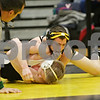 Rob Winner – rwinner@shawmedia.com<br /> <br /> Sycamore's Kyle Akins (top) controls Kaneland's Stephen Gust during their 113-pound finals match at the Class 2A Sycamore Regional on Saturday, Feb. 2, 2013. Akins won by technical fall.