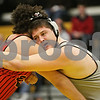 Rob Winner – rwinner@shawmedia.com<br /> <br /> Kaneland's Zach Theis (right) competes against Rockford East's Mike Estergard during their 285-pound finals match at the Class 2A Sycamore Regional on Saturday, Feb. 2, 2013. Theis won with a 2-0 decision.