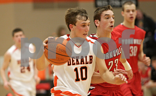 Rob Winner – rwinner@shawmedia.com<br /> <br /> DeKalb's Pat Aves (10) moves the ball up the court during the third quarter in DeKalb, Ill., Friday, Feb. 15, 2013. Yorkville defeated DeKalb, 50-43.
