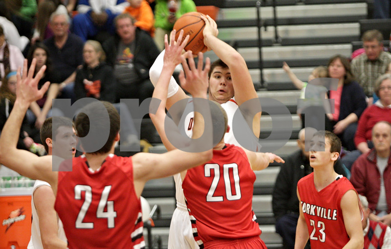 Rob Winner – rwinner@shawmedia.com<br /> <br /> DeKalb's Jake Smith (center) looks to pass during the second quarter in DeKalb, Ill., Friday, Feb. 15, 2013. Yorkville defeated DeKalb, 50-43.