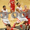 Rob Winner – rwinner@shawmedia.com<br /> <br /> DeKalb's Rudy Lopez (center) scores on a layup during the second quarter in DeKalb, Ill., Friday, Feb. 15, 2013. Yorkville defeated DeKalb, 50-43.
