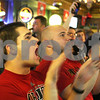 Rob Winner – rwinner@shawmedia.com<br /> <br /> Northern Illinois alumni Daniel Nolte, of Bartlett, and Alex Woltman, of Wheaton, react to a play in the first of the Orange Bowl while watching the game at Fatty's Pub & Grille in DeKalb, Ill., Tuesday, Jan. 1, 2013.