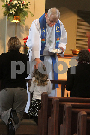Gary L. Gates — For the Daily Chronicle<br /> <br /> Pastor Robert Weinhold of the Evangelical Lutheran Church of Sycamore gives a blessing to five year old Natalie Spector during communion at Sunday services  yesterday.