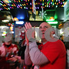 Rob Winner – rwinner@shawmedia.com<br /> <br /> Northern Illinois alum Mark Nelson, of Naperville, cheers on the Huskies during the Orange Bowl introductions while watching the game with friends at Fatty's Pub & Grille in DeKalb, Ill., Tuesday, Jan. 1, 2013.