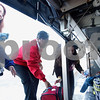 Erik Anderson - For the Daily Chronicle<br /> <br /> Northern Illinois University seniors (from left), Nicole Rutan and Steavy Mikrut get help loading their luggage from Bus Operator Rhonda Dukes Sunday, December 30, 2012.
