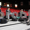 Erik Anderson - For the Daily Chronicle<br /> <br /> Northern Illinois University seniors (from left) Denton Striplin, Colin Albue, Robert Munro and Jacob Onak sit inside the Convocation Center Sunday, December 30, 2012 while waiting to be called to their bus.