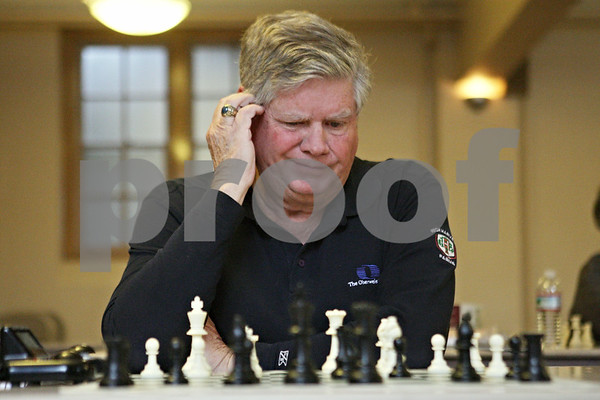 Rob Winner – rwinner@shawmedia.com<br /> <br /> Newly elected state Senator Jim Oberweis looks over his board while contemplating his next move at the U.S. Chess Federation Home for the Holiday event at First Congregational United Church of Christ in DeKalb, Ill., Saturday, Dec. 29, 2012.