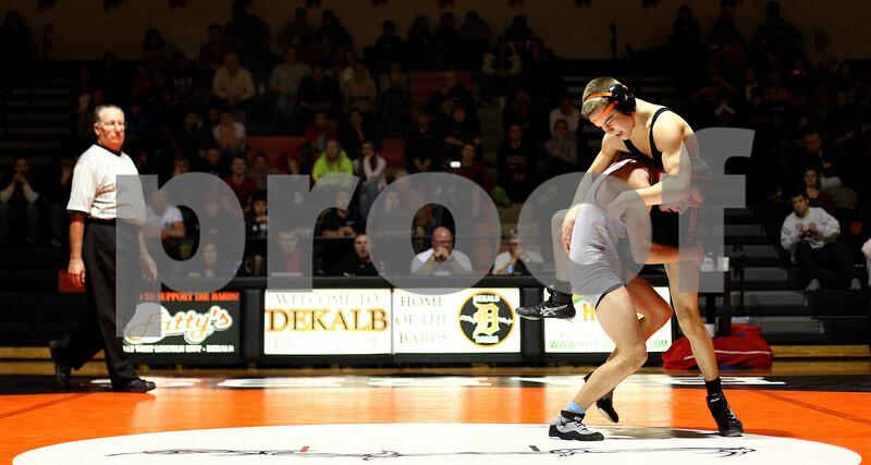 Kyle Bursaw – kbursaw@shawmedia.com<br /> <br /> Yorkville's Dan Cikauskas takes down DeKalb's Brenden McGee in their 113-pound match at DeKalb High School on Thursday, Jan. 3, 2013. Cikauskas defeated McGee 6-3.