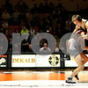 Kyle Bursaw – kbursaw@shawmedia.com<br /> <br /> Yorkville's Dan Cikauskas takes down DeKalb's Brenden McGee in their 113-pound match at DeKalb High School on Thursday, Jan. 3, 2013. Cikauskas defeated McGee 6-3.