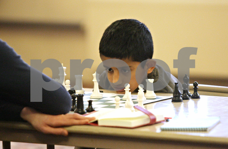 Rob Winner – rwinner@shawmedia.com<br /> <br /> Suraj Ramanathan, 8 of Wheaton, waits for his opponent to make a move at the U.S. Chess Federation Home for the Holiday event at First Congregational United Church of Christ in DeKalb, Ill., Saturday, Dec. 29, 2012.