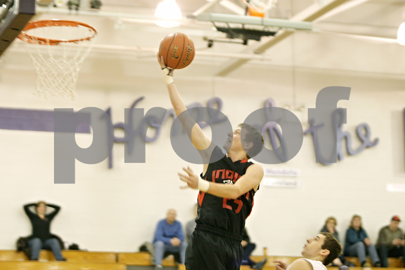 Rob Winner – rwinner@shawmedia.com<br /> <br /> Indian Creek's Tyler Reynolds (23) puts up two in the fourth quarter at the Plano Christmas Classic on Saturday, Dec. 29, 2012. Yorkville defeated IC, 69-65.