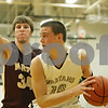 Rob Winner – rwinner@shawmedia.com<br /> <br /> Morris' Ben Ortiz (34) pressures Sycamore's Devin Mottet (15) late during the fourth quarter in Sycamore, Ill., Friday, Jan. 4, 2013. Morris defeated Sycamore, 41-39.