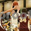 Rob Winner – rwinner@shawmedia.com<br /> <br /> Sycamore's Kyle Buzzard (22) is fouled by Morris' Jason Matteson (not pictured) in the first quarter in Sycamore, Ill., Friday, Jan. 4, 2013. Morris defeated Sycamore, 41-39.