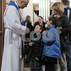 Gary L. Gates — For the Daily Chronicle<br /> <br /> Pastor Robert Weinhold of the Evangelical Lutheran Church of Sycamore speaks to Trent Thomas, left, and his sister Kylie following Sunday services.  The kids' aunt, Cindy Leffleman, listens from behind.
