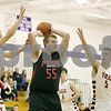 Rob Winner – rwinner@shawmedia.com<br /> <br /> Indian Creek's Garrison Govig (55) looks to pass in the first quarter at the Plano Christmas Classic on Saturday, Dec. 29, 2012. Yorkville defeated IC, 69-65.