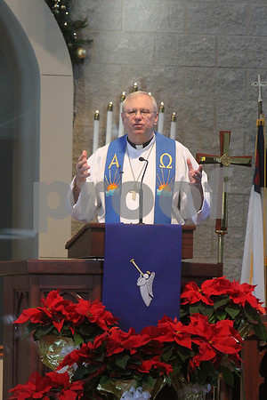 Gary L. Gates — For the Daily Chronicle<br /> <br /> Robert Weinhold, Pastor of the Evangelical Lutheran Church of St. John in Sycamore, gestures while giving his sermon on Sunday.