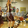 Rob Winner – rwinner@shawmedia.com<br /> <br /> Morris' Austin Patterson (24) pressures Sycamore's Mark Skelley (right) during the third quarter in Sycamore, Ill., Friday, Jan. 4, 2013. Morris defeated Sycamore, 41-39.